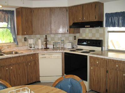 Spacious Eat-In Kitchen with Window Open to Lanai