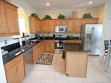 Kitchen features granite counter tops, stainless steel appliances