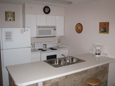 Fully equipped kitchen: stove, range, dishwasher,disposal, appliances, utensils