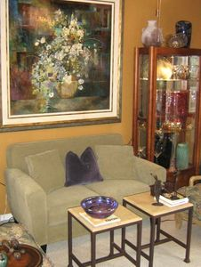 Den with beautiful art glass and furnishings