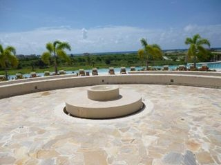 Punta Cana condo photo - Balcony where you step down to the infinity pool area/spa overlooking the ocean.