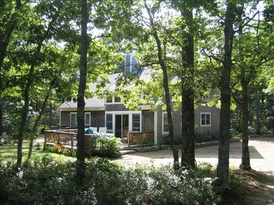 Exterior with deck in lovely wooded setting