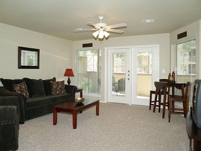 Living Room with small eating table. Patio doors to right.