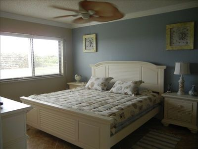 Coastal Living master bedroom with Tempur-Pedic king bed, large walk-in closet