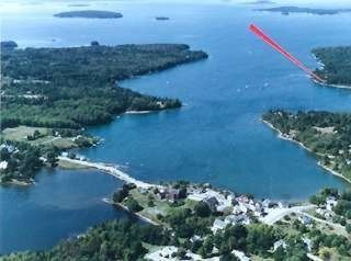 View from air, cottage at point of red arrow