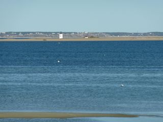 Provincetown condo photo - Straight-on views of Long Point, lighthouse, and Truro bluffs in the distance