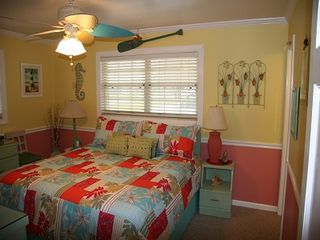 Anastasia Island house photo - Master bedroom with king size bed. Beachy ceiling fan matches comforter.