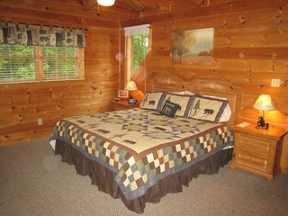 Gatlinburg cabin photo - Upstairs King Size bedroom with TV, DVD and VCR. Private balcony.