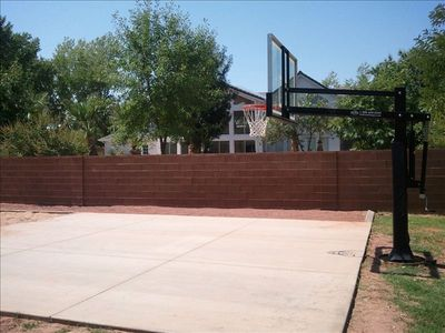 basketball court with adjustable hoop
