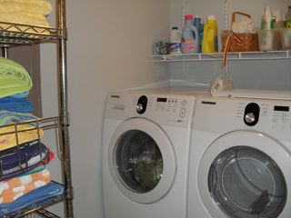 Wildwood condo photo - Full size Samsung washer and dryer, ironing board, iron, beach and bath towels
