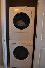 Gulf Shores condo photo - Stacked front loading washer/dryer in unit for your convenience