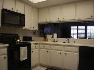 Kitchen with pass thru - Palm Desert condo vacation rental photo
