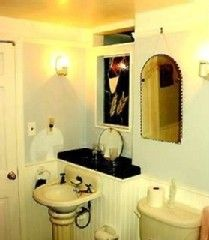 Yarmouth townhome photo - Upstairs bathroom with Clawfoot tub, stained glass