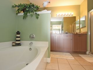 Isle of Palms condo photo - Master bath has double sinks, separate walk-in shower, & garden tub