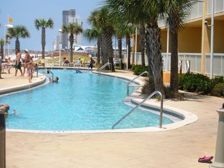 Calypso Resort condo photo - Two lagoon-style gulf front pools. One is heated in season.
