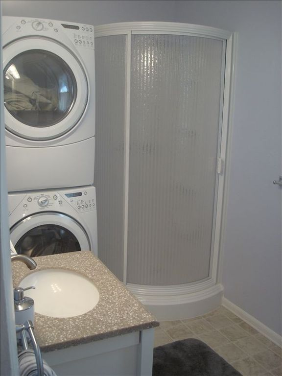 Downstairs Bath is complete with a Shower and Laundry Facilities