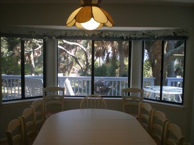 Eating area, outside deck and large private lot with a partial ocean view