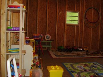 Separate playroom in level part of yard
