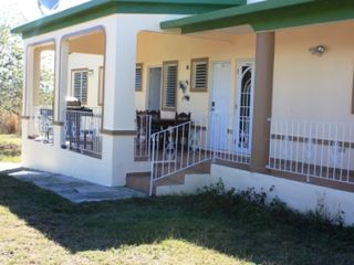 Guayama house photo - Back porch with grill and table (laundy room and half bathroom)