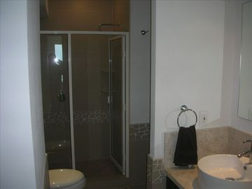 Large shower with rain showerhead in both bathrooms