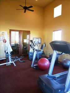 The work-out room has everything you need including a large flat screen TV