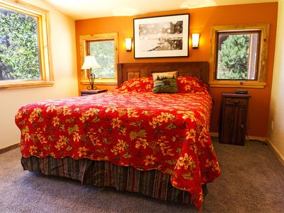Master bedroom with king bed facing back deck and private bathroom.