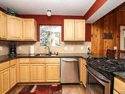 newly remodeled kitchen with granite countertop and stainless appliances