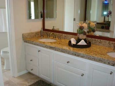 Spacious Master Bathroom with Double Vanity and Granite Counters