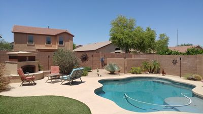 Beautiful 4 Bedroom Home with Heated Pool, Custom Grill & Outdoor Fireplace