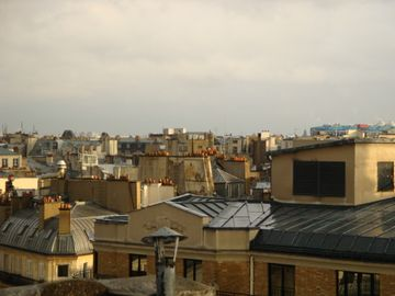 View from the bedroom to the roofs of Paris