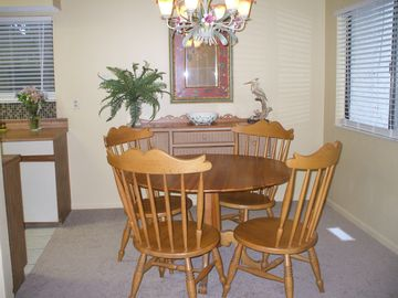 The Dining Area features a pine/rattan sideboard and a pine table.