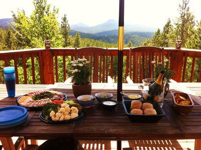Summer - Enjoy lunch or dinner & the views on the back deck. Seats 6.