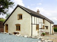 HOLLY COTTAGE, pet friendly, with a garden in Lower Wood, Ref 2041