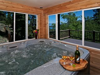 Heavenly Valley cabin photo - Enclosed hot tub. Room is not heated. Can open windows and slider to deck.