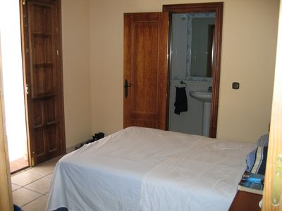 Main bedroom with access to the pool