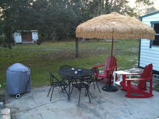 Mexico Beach mobile home photo - New Adirondack rocking chairs and umbrella.