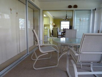 On the enclosed porch looking into the family room.