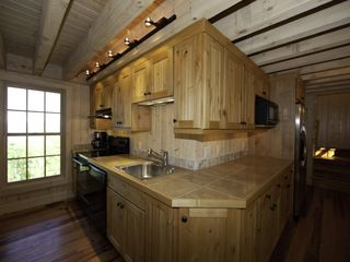 Sapphire cottage photo - The kitchen opens onto the screened living room/porch.