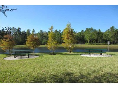 Kissimmee condo rental - Bar -B - Q Area + Picnic Tables.