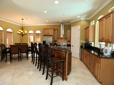 Dining area and Kitchen with stainless steel appliances and granite countertops