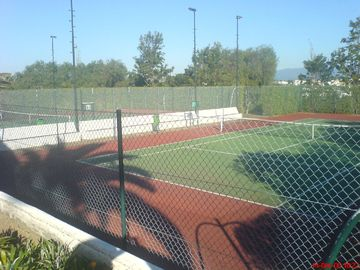 One of the two flood lit tennis courts