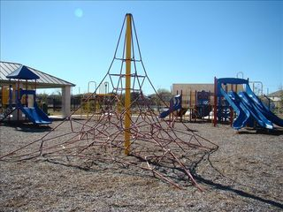 Park playground area with picnic tables - San Antonio house vacation rental photo