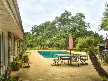 Austin house rental - Relax by the salt water pool, big deck and lush vegetation.