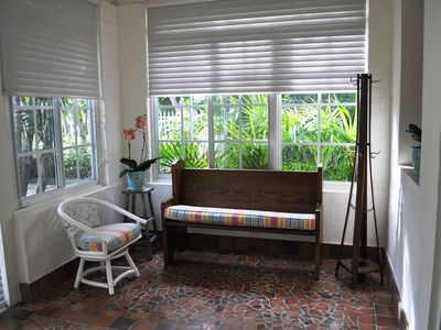 Alternate view of sunroom and garden view with orchids