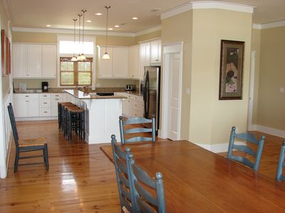 XL kitchen w/ lots of space to entertain. Kitchen/Dining opens to screen porch!