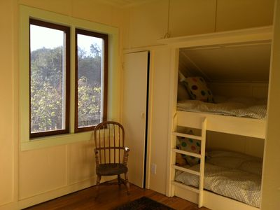 Twin bunk beds in one of the children's rooms