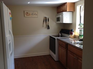 Brand new kitchen cabinets, flooring and appliances