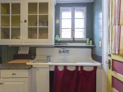 Original farm sink in the kitchen with old glass cabinets