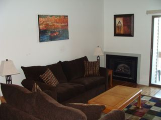 Weirs Beach condo photo - Comfortable couches and fireplace with electric insert