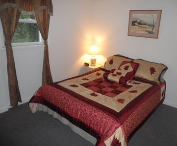 Comfy Queen bed with reading lamp and spacious two door closet in the main room!
